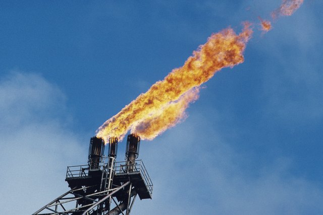"""Offshore oil platform; """"burn off""""  oil fume flames, low angle view"""