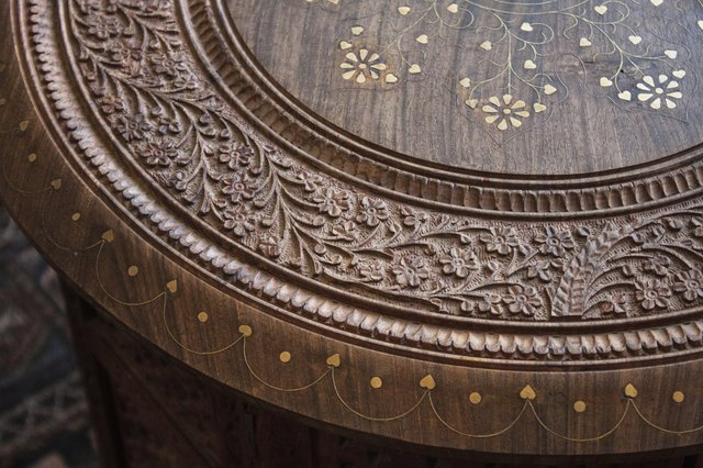 Top of carved wooden coffee table with flower pattern