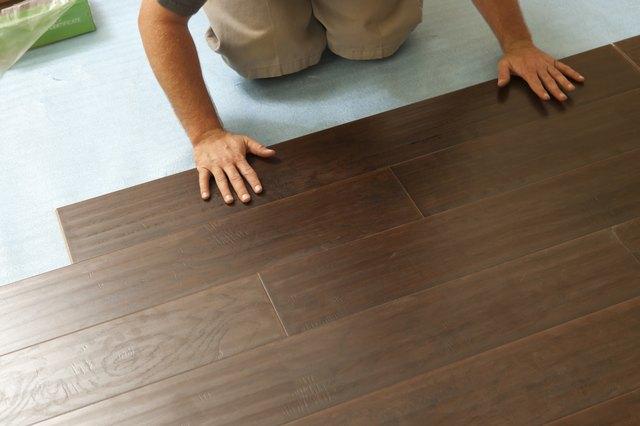 cost of carpet vs laminate flooring hunker. Black Bedroom Furniture Sets. Home Design Ideas