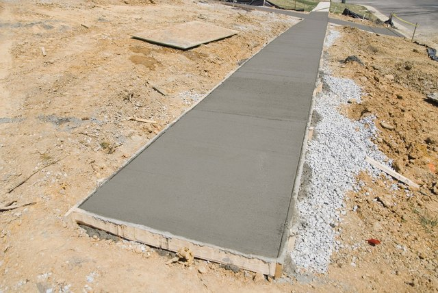 Wet cement sidewalk at construction site