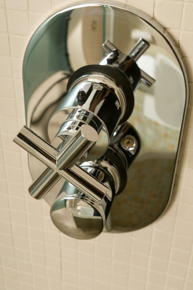 Close-up of faucet in shower