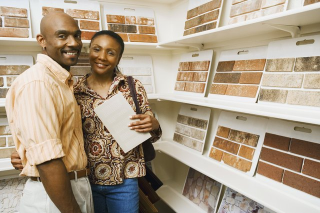 Smiling couple by tile samples