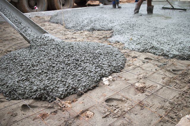 Concrete consists of cement, rocks and other ingredients mixed with water.