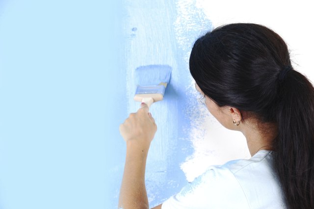 woman paint on wall