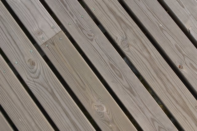 How to tell if deck is cedar or pressure treated hunker for Cedar decking pros and cons