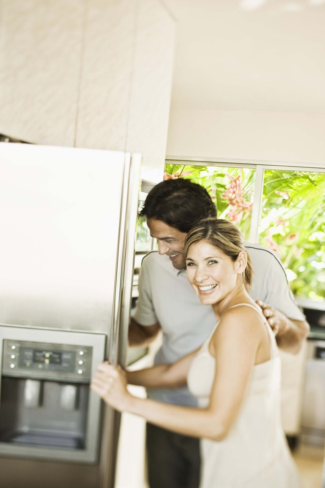 Couple by refrigerator