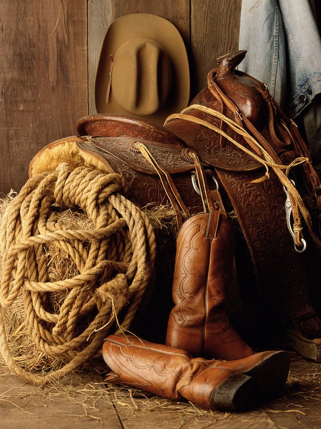 Photo, saddle, rope, boots and hat, Color