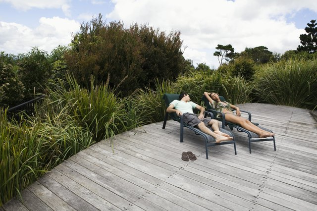 Couple relaxing on deck