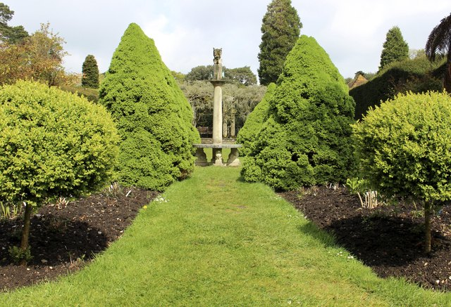 Image of formal garden with topiary trees, shrubs and sundial