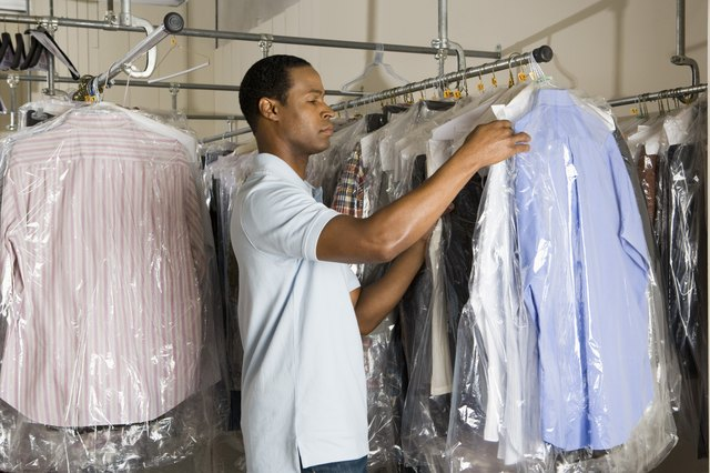 Man working at dry cleaners