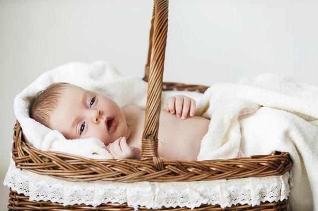 Baby in wicker basket.