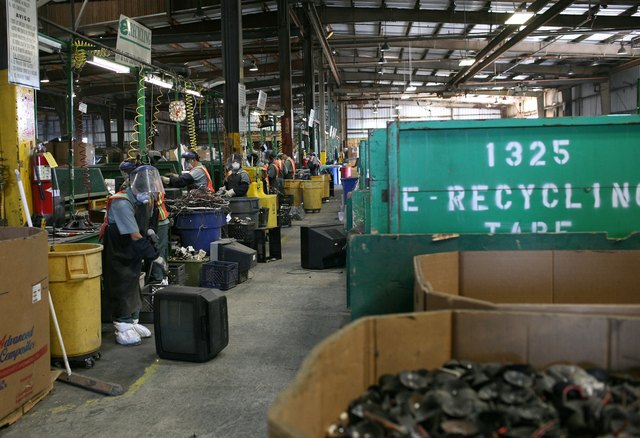 Recycling Center Processes Toxic Components From Old Television Sets
