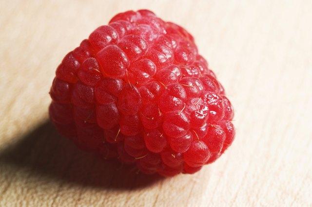 Macro of raspberry on wood cutting-board