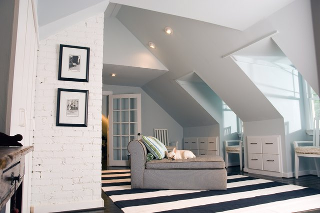 Spacious upscale bedroom with dog lounging