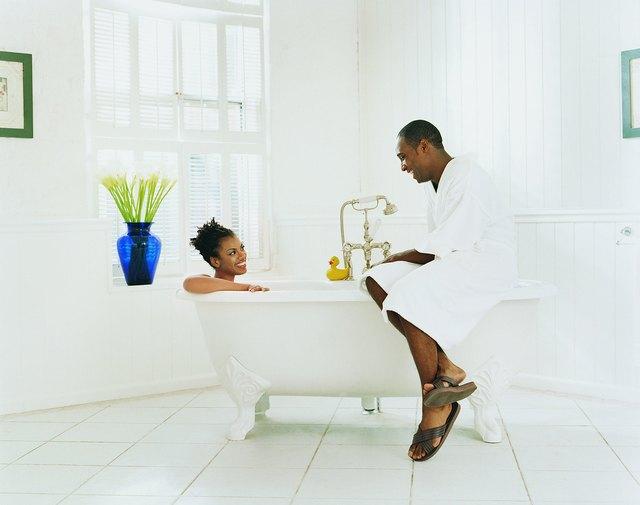 Couple Sitting in a Bathroom