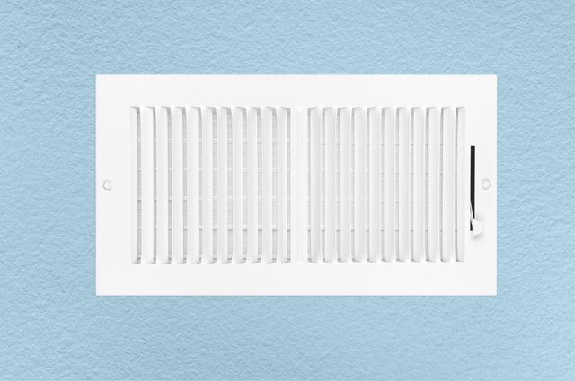 Air conditioning and heating vent on wall