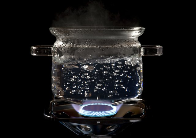 clear cooking pot on a gas stove