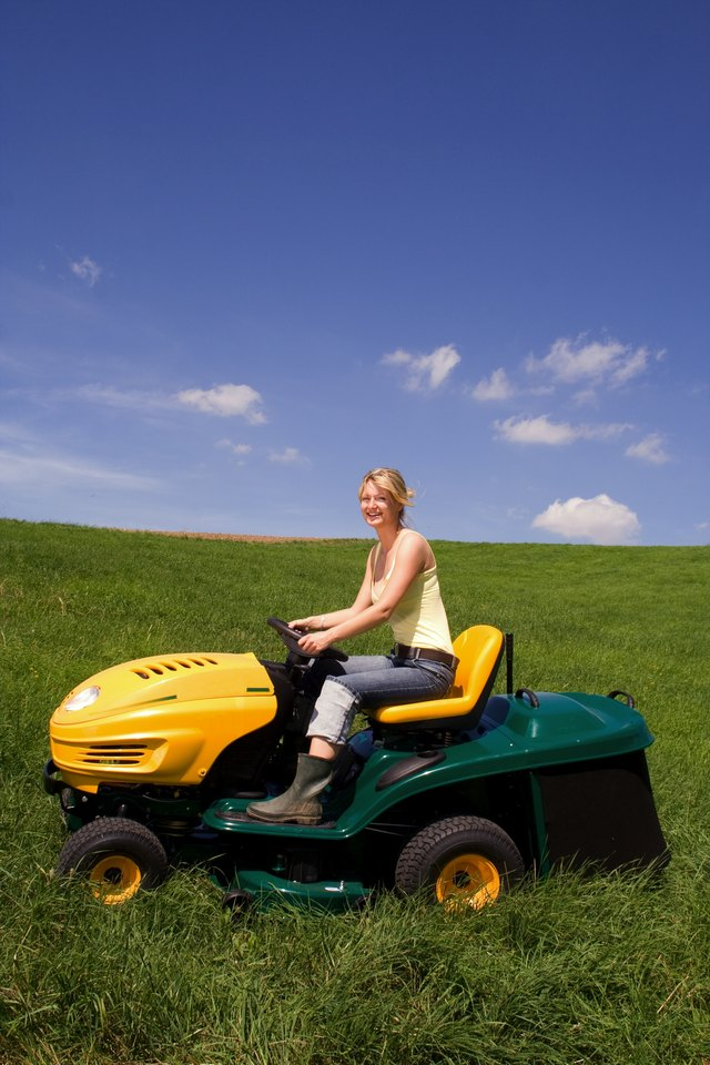 young girl on lawn mower 1