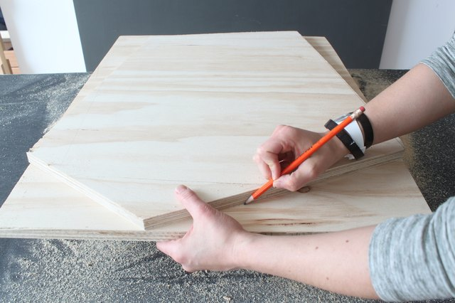Tracing cut lines on second piece of plywood