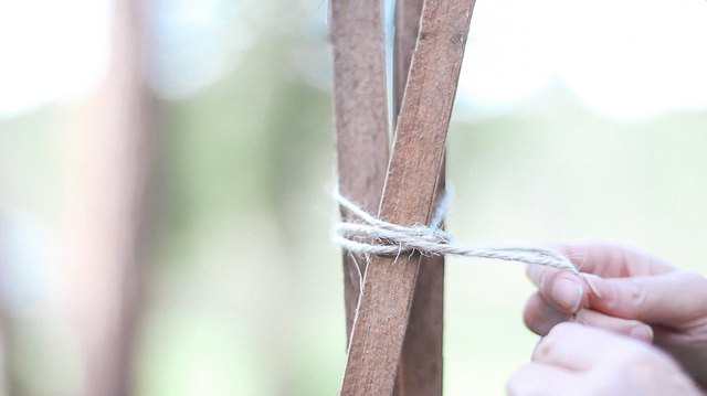 Tying wood stakes together