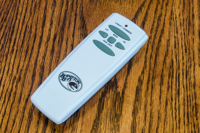 How to troubleshoot a hampton bay ceiling fan remote control hunker this is the first step when troubleshooting a ceiling fan remote the easiest fix to any remote control problem begins with battery replacement mozeypictures Choice Image