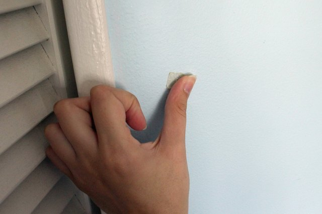 how to remove tape adhesive from painted walls hunker