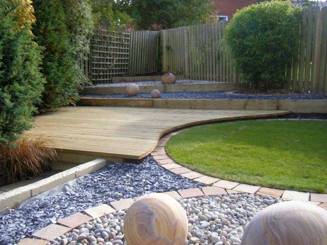 interlocking hardwood deck and grass lawn