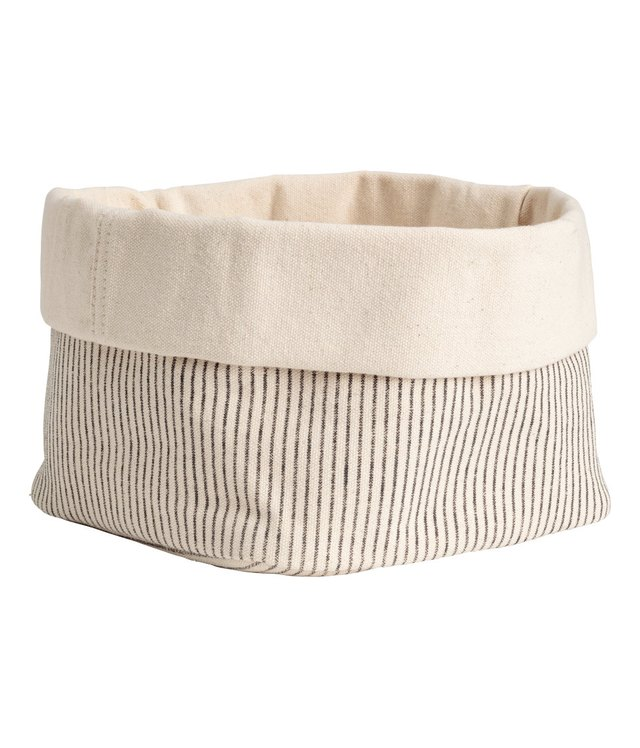 Beige canvas storage basket with black pin stripes