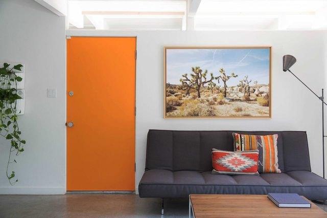 room with orange door