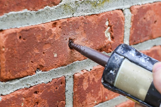 how to patch holes in a brick wall hunker. Black Bedroom Furniture Sets. Home Design Ideas