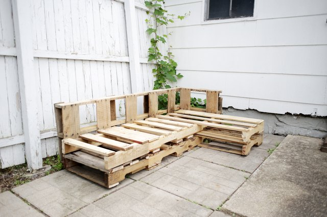 Side view of L-shaped wood pallet couch.