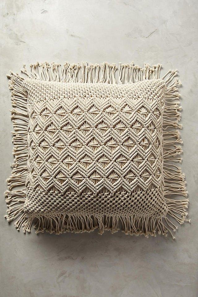 Anthropologie fringed floor pillow.