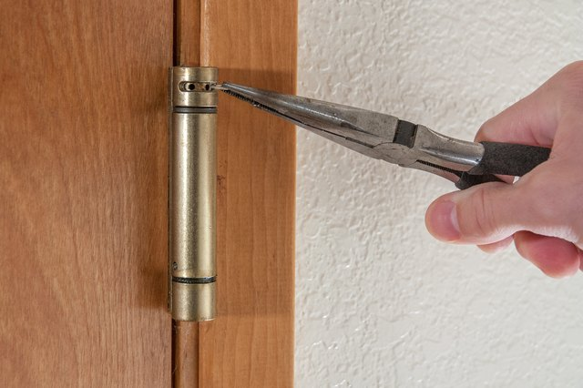 How To Adjust A Spring Loaded Door Hinge Hunker