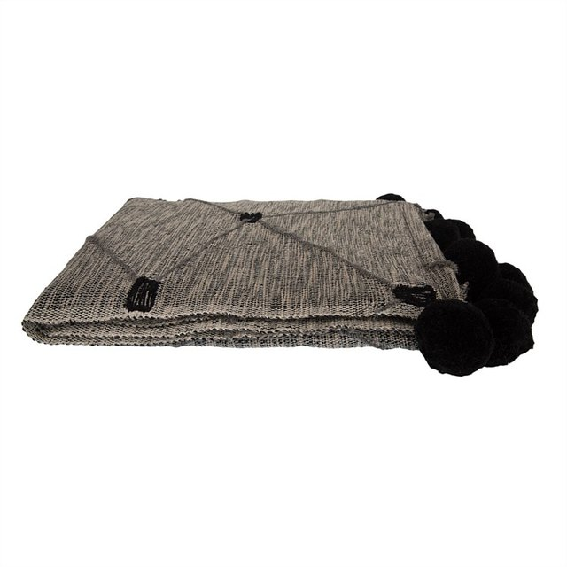 Black and gray throw blanket with black pom poms