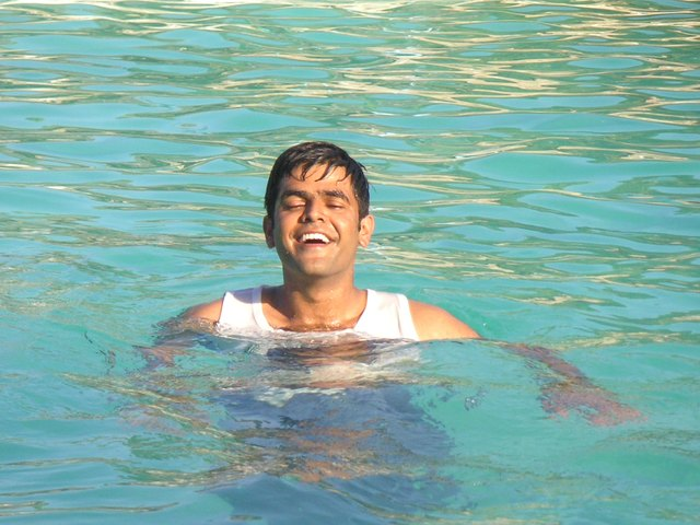 Swimming pool with greenish water.