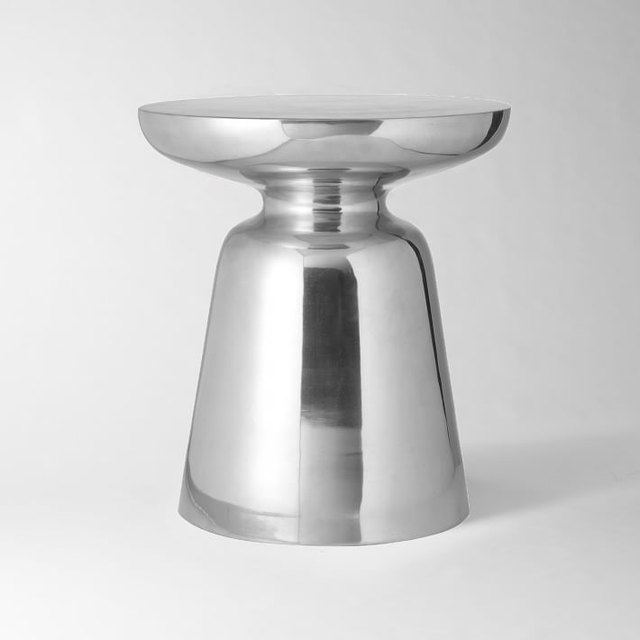 Solid small round mod side table with chrome finish