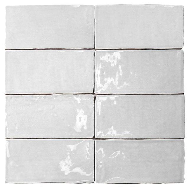 Eight pieces of white subway tile