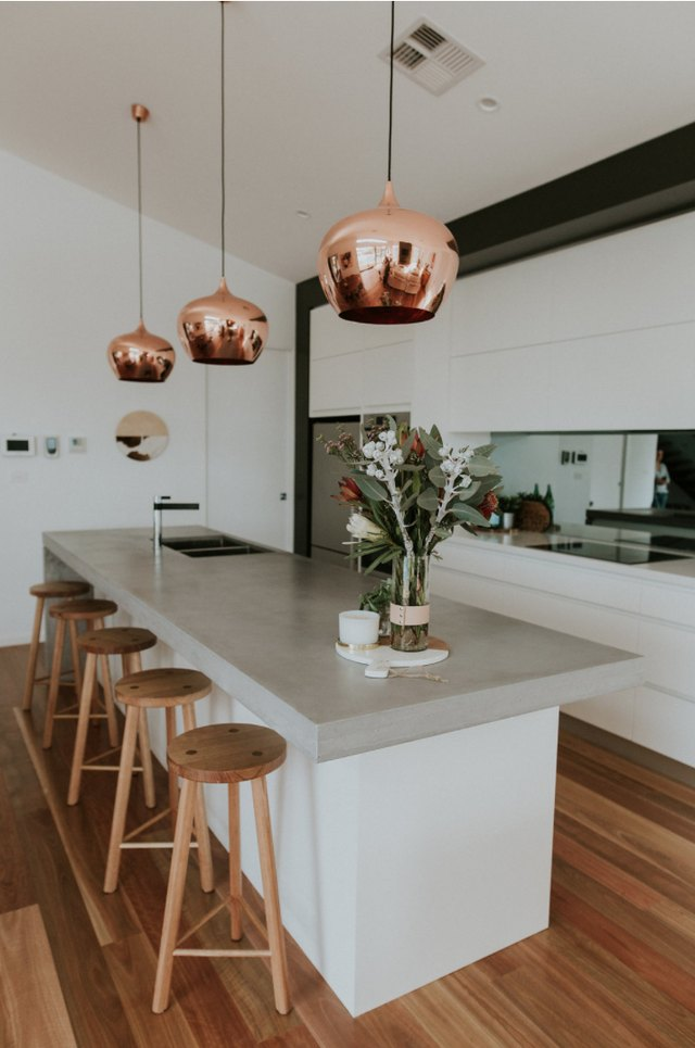 Kitchen with copper pendant light