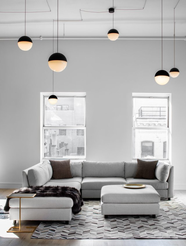 living room with suspension pendant lighting
