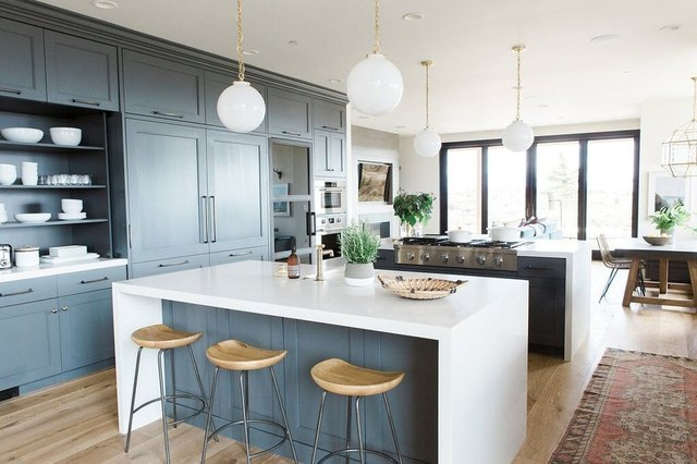 Two Large Islands Stand In An Open Kitchen.