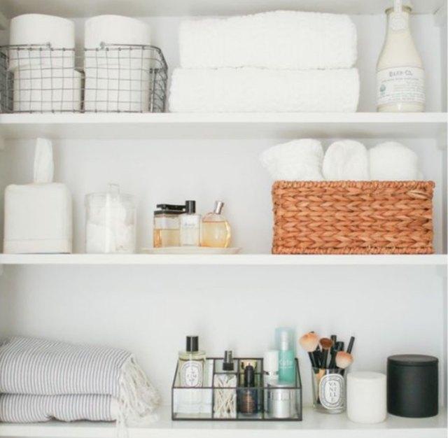 baskets in linen closet