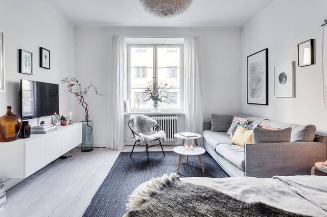 small apartment living room with light, neutral paint color