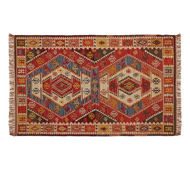 Small red and blue variegated rug