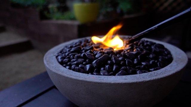 Lighting DIY tabletop concrete fire bowl.