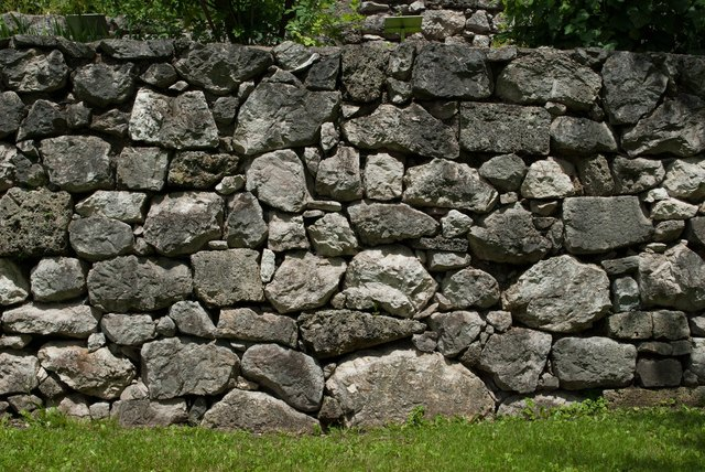 Stone stacked together as a wall.