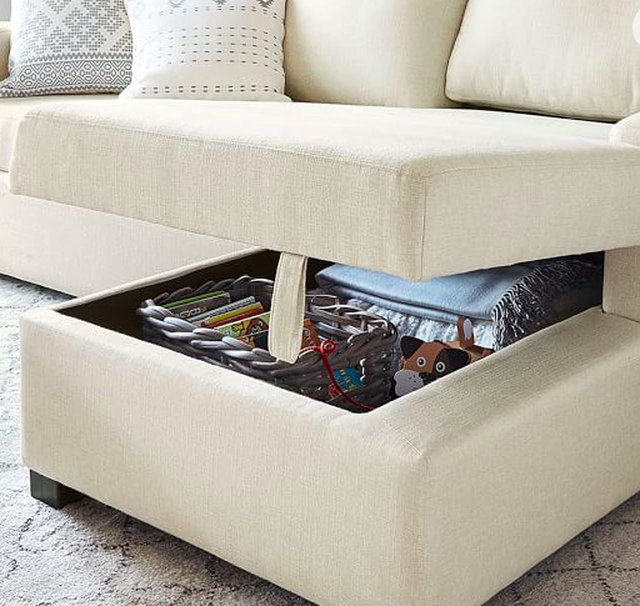 white couch with chaise storage