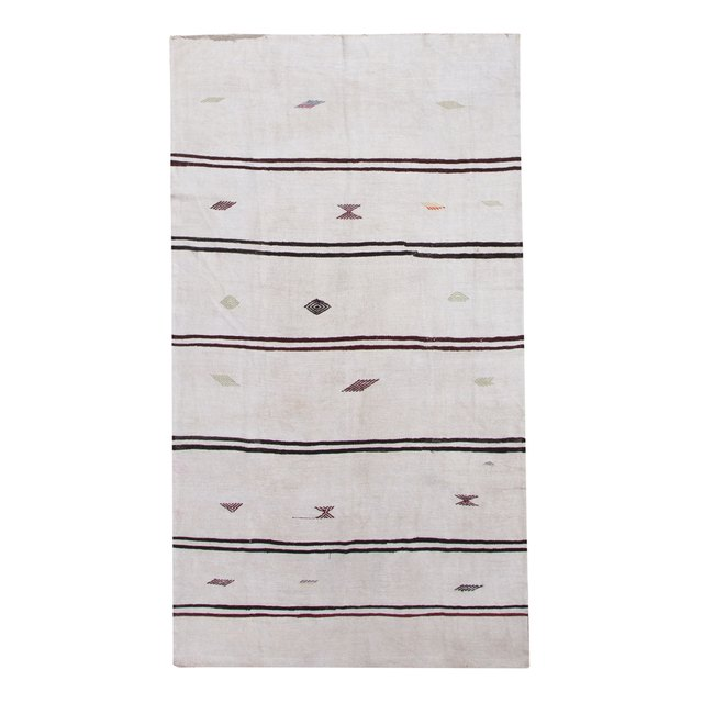 Cream horizontal striped area rug with tribal details