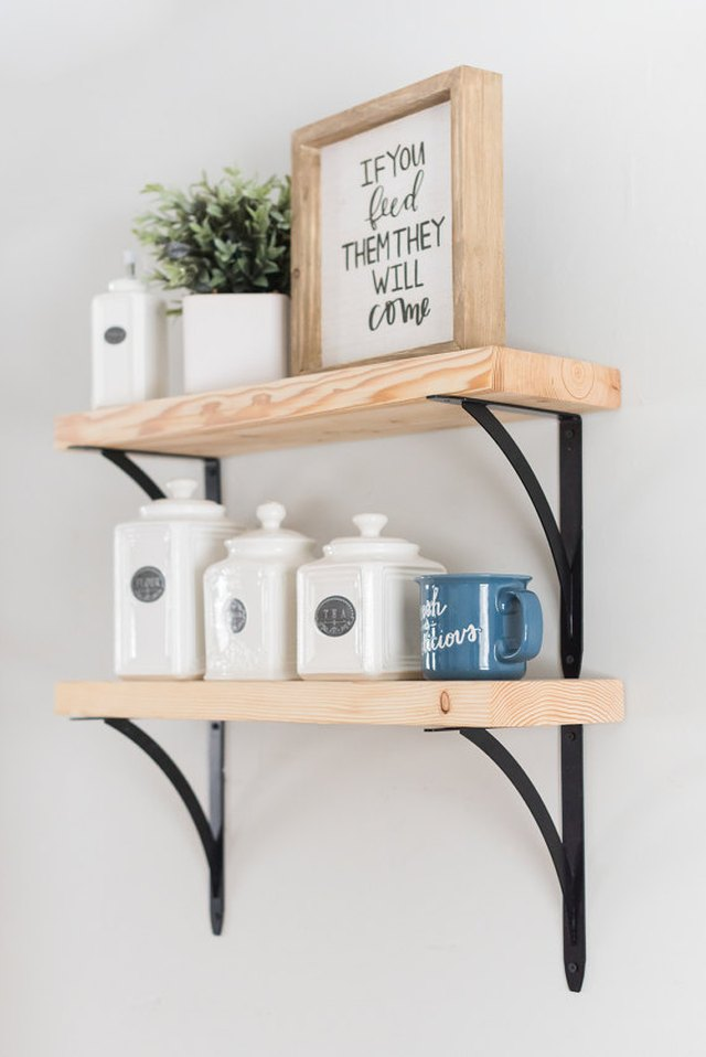 Two wooden shelves with black brackets