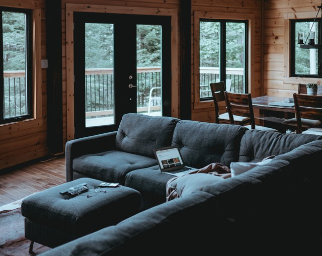 Wood paneling in dark living room.