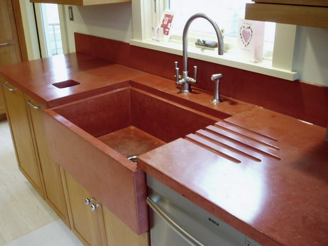 Red concrete countertop and custom-cast sink